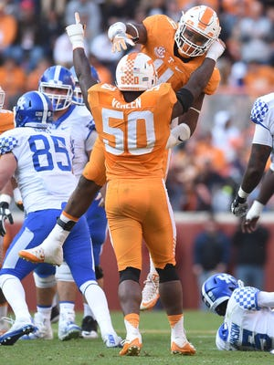 Tennessee defensive lineman LaTroy Lewis (4) celebrates with defensive lineman Corey Vereen (50) during the second half at Neyland Stadium on Saturday, Nov. 12, 2016.
