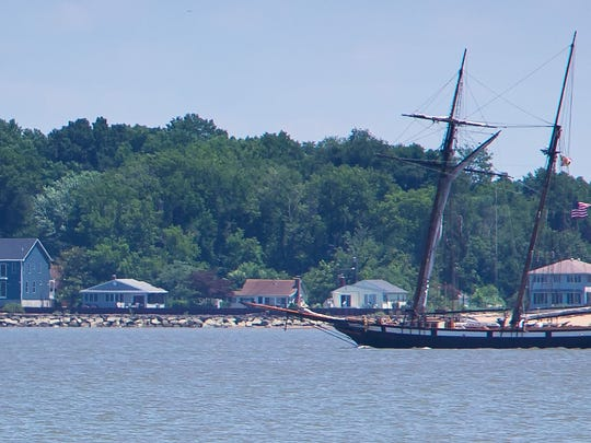 Tall ships sail the Delaware River near New Castle   on June 24. City officials hope to build a pier for ships to dock.
