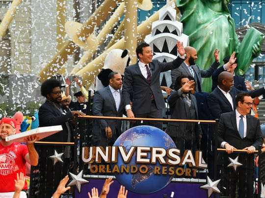 "The April 6 Grand Opening for ""Race Through New York Starring Jimmy Fallon"" at Universal Orlando Resort. The Thursday event included a colorful parade with Jimmy Fallon himself riding on a float to cut the ribbon for the new attraction."