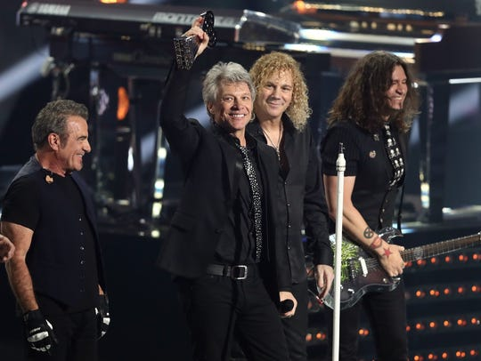 Jon Bon Jovi, left, and David Bryan of Bon Jovi  accept