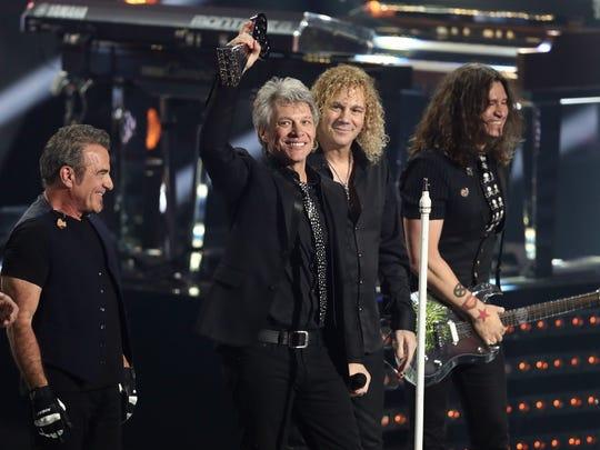 Jon Bon Jovi, left, and David Bryan of Bon Jovi  accept the Icon Award on March 11, 2018, in Inglewood, California.