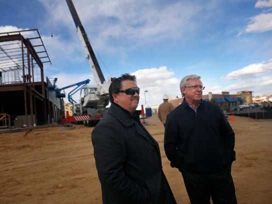 Property owners Kerwin Gober, left, and Terry Tobey tour their construction site on Thursday at the new GoTo Plaza in Farmington.