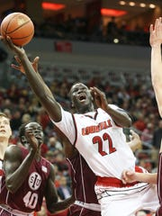 U of L's Deng Adel (22) stretches for shot against SIU during their game at the KFC Yum! Center.Dec. 7, 2016