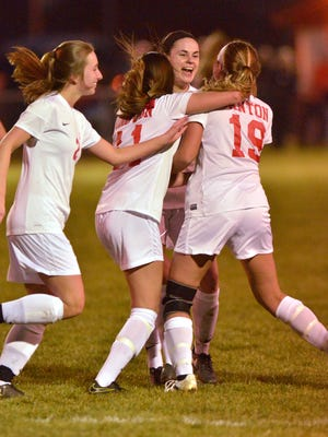 Canton players celebrate after scoring in the second half against Northville. The goal turned out to be the difference in a 2-1 win.