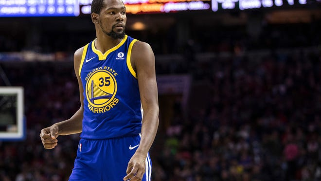 """FILE - In this Nov. 18, 2017, file photo, Golden State Warriors' Kevin Durant pauses during the first half of an NBA basketball game against the Philadelphia 76ers in Philadelphia. Draymond Green and Durant bet on just about anything. """"Life,"""" Green explained, """"who drives home faster from the practice facility, who gets to the game earlier. You want us to tell you our whole life?"""" KD and Dray have formed quite a bond since way back, when Green was part of the strategic recruiting process to bring Durant to the Bay Area from Oklahoma City before last season. (AP Photo/Chris Szagola, File)"""