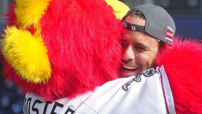 """Nashville"" star Charles Esten get a hug from Nashville Sounds mascot Booster before the City of Hope celebrity softball game Saturday."