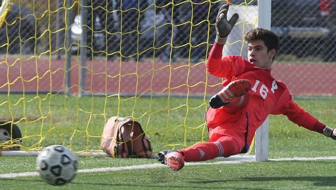 Yorktown goalie Giuliano Santucci has a ball get past him on a penalty kick from Arlington during the Section One Class AA boys final at Arlington High School, Oct. 31, 2015.