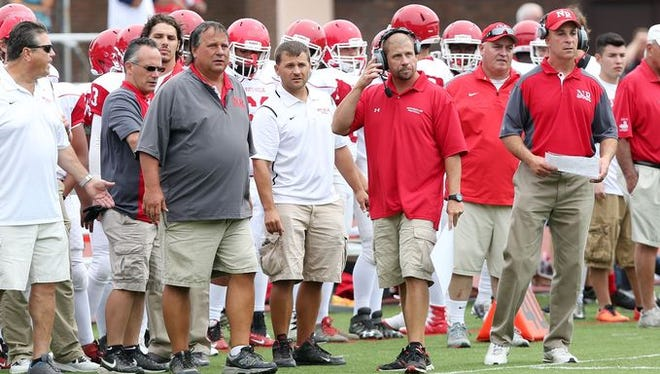 Tom Lynch (in gray) watches his team during North Rockland's game at New Rochelle High School on Sept. 3, 2016. Lynch was named the Varsity Insider Week 7 Coach of the Week.