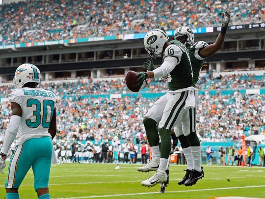 New York Jets wide receiver Jermaine Kearse (10) celebrates after his touchdown against the Miami Dolphins during the first half at Hard Rock Stadium.