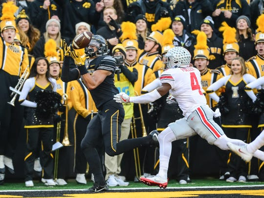 Iowa tight end Noah Fant beats safety Jordan for a