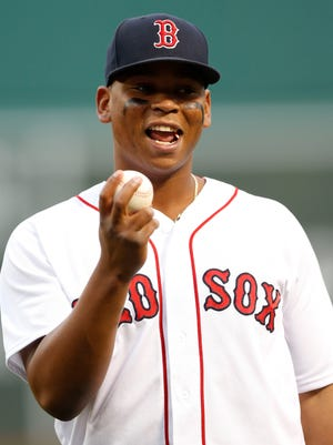 Red Sox 3B Rafael Devers is a finalist for USA TODAY Sports'  Minor League Player of the Year award .