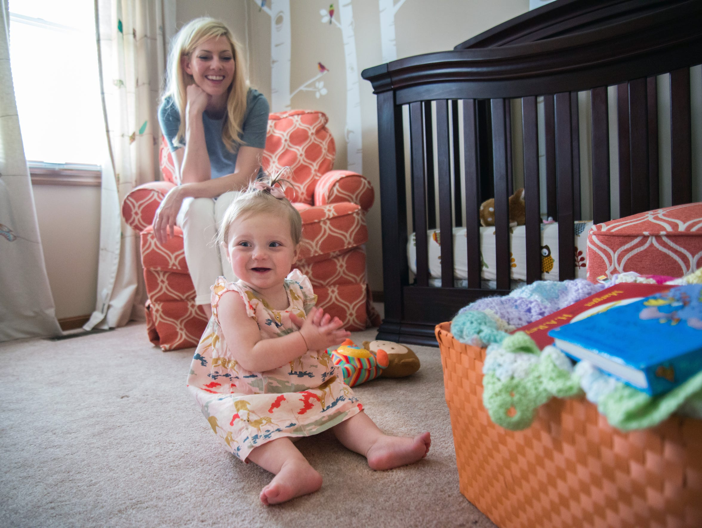 Anna Lazor plays with her daughter, Avery.