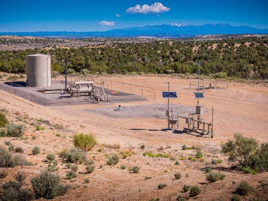A tank and other infrastructure remained on a vacant XTO Energy well pad near Aztec in this file photo.
