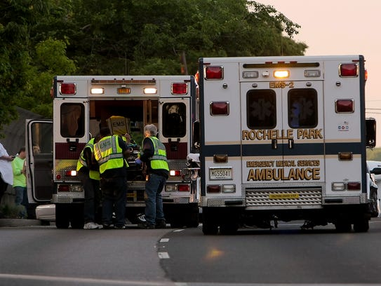 An injured person is loaded onto an ambulance  on Rt.17