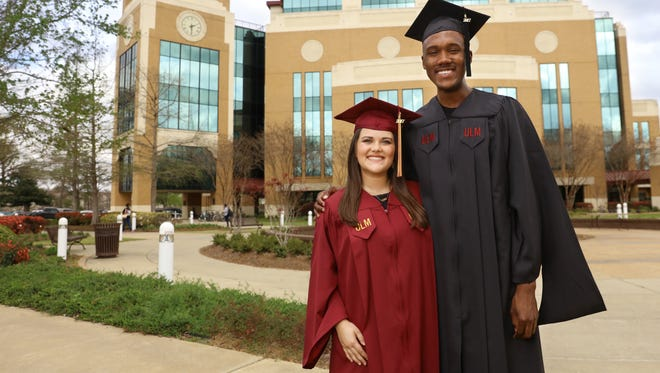 Kaitlin Neal Arnett and Kendrick Jones model ULM's new commencement robes.