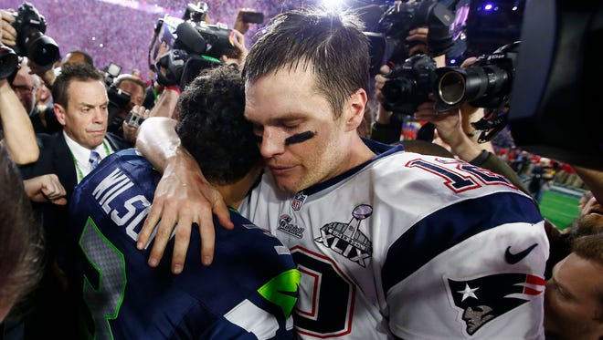 New England Patriots Tom Brady hugs Seattle Seahawks Russell Wilson at Super Bowl XLIX on Sunday, Feb. 1, 2015 in Glendale, AZ.