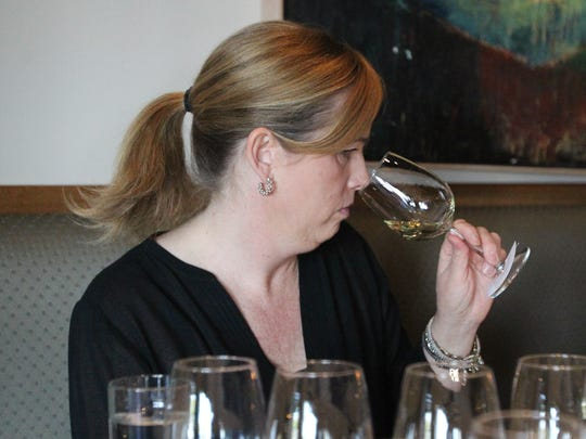 Katie Stephens, of Beckett's Table, sniffs a white wine at The Arizona Republic Wine Competition at Tarbell's in Phoenix,  Arizona on October 26, 2015. (Photo by Ben Margiott/The Republic)