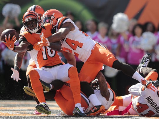 Cincinnati Bengals wide receiver A.J. Green (18) catches a deep pass in the end zone as time expires in the second quarter during the NFL Week 7 football game between the Cleveland Browns and the Cincinnati Bengals, Sunday, Oct. 23, 2016, at Paul Brown Stadium in Cincinnati. Cincinnati leads 21-10 at halftime.