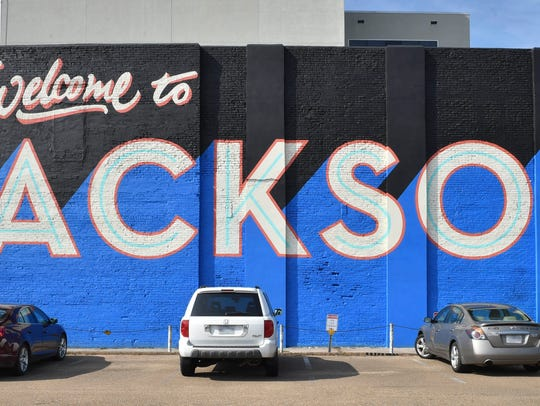 "The completed ""Welcome to Jackson"" mural on the wall"