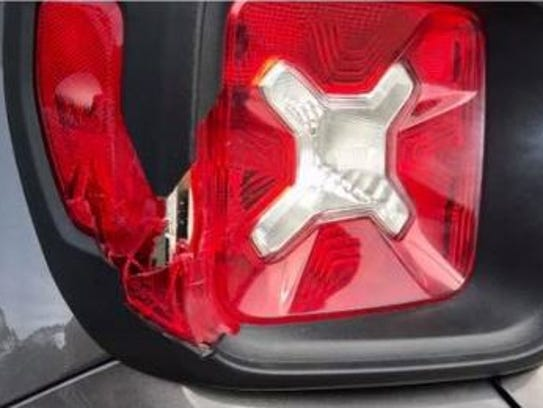 A broken taillight was part of the damage in what Green