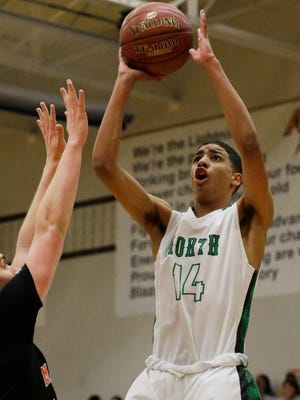 Oshkosh North High SchoolÕs Tyrese Haliburton puts up a shot on the inside against the Marshfield defense.  Oshkosh North takes on Marshfield in boys WIAA playoff action at Appleton North High school, March 9, 2017.  North beat Marshfield 67 - 54.Joe Sienkiewicz / USA TODAY NETWORK-Wisconsin