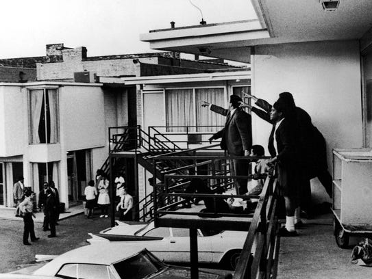 People on the balcony of Lorraine Motel point in direction