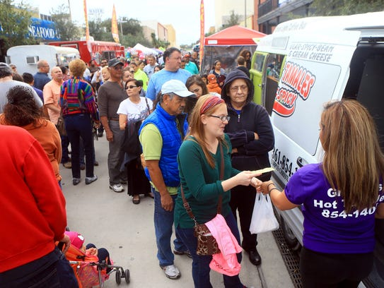 People stand in line to order Tamales during Tamale