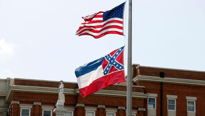 The American flag and Mississippi state flag fly outside the Forrest County Courthouse in Hattiesburg.