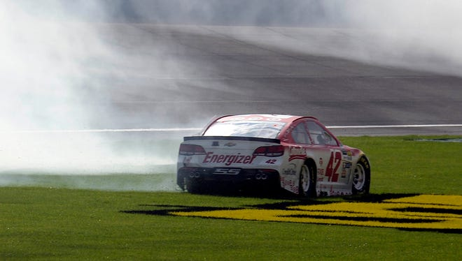 Kyle Larson takes a spin in the grass after winning the Auto Club 400 Sunday.