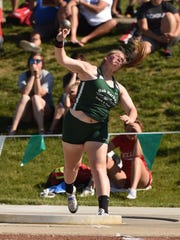 Oak Harbor's Emily Wolf throws the shot put during