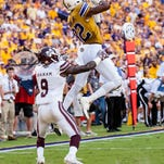 LSU Tigers wide receiver D.J. Chark (82) with the near catch during the first half of a SEC game between Mississippi State and the LSU Tigers in Death Valley on Saturday Sept. 17, 2016.