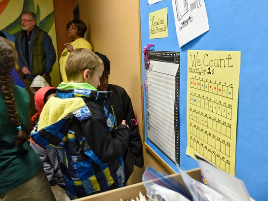 Children sign in for math night activities Friday,