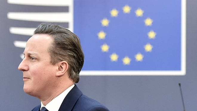 British Prime Minister David Cameron arrives for an EU summit in Brussels on Feb. 19.