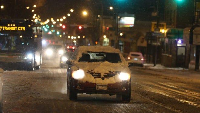 A car heads down Monroe Avenue Monday morning.