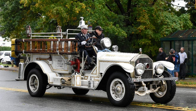 Members of the Tenafly Fire Department in the 1920 American LeFrance fire engine during the 2016 Northern Valley Fire Chiefs Parade.