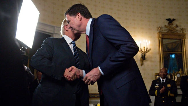 President Trump and FBI Director James Comey on Jan. 22, 2017.