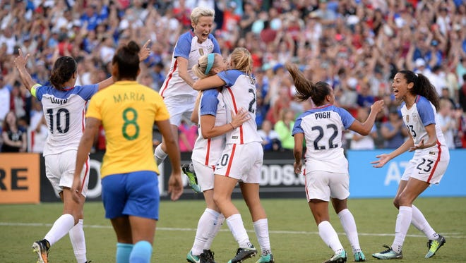 United States defender Julie Ertz (8) is congratulated by teammates after scoring a goal as Brazil midfielder Maria (8) looks on during the U.S.'s 4-3 win at Qualcomm Stadium.