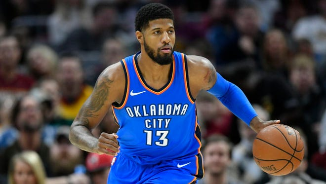 Thunder forward Paul George brings the ball up court in the first quarter against the Cavaliers at Quicken Loans Arena in Cleveland on Jan. 20.