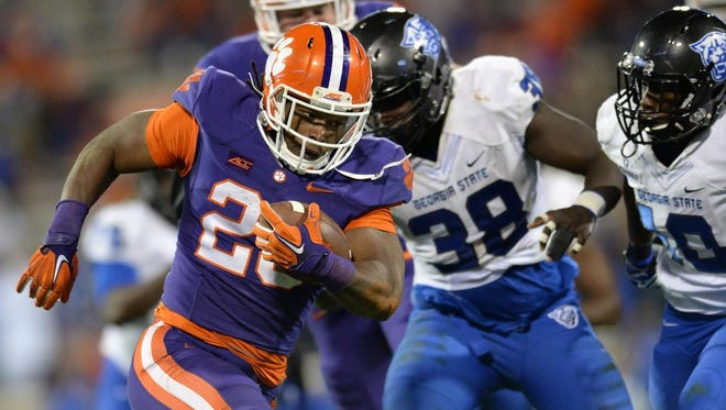 Clemson running back Tyshon Dye (23) carries against Georgia State on Saturday.