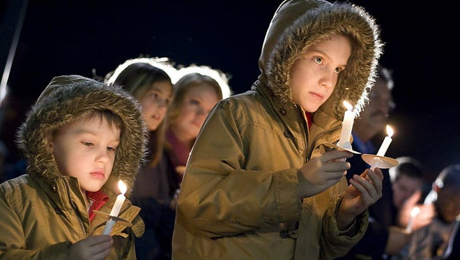 Candlelight vigil in 2012 in Sanford, N.C.,for the shooting victims at Sandy Hook Elementary School in Newtown, Conn.