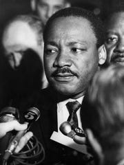 10:40 a.m. Wednesday, April 3, 1968 - Dr. Martin Luther King Jr. speaks to the press after his arrival at the Memphis airport. Behind him (at right) is aide, Ralph Abernathy. (By William Leaptrott, Courtesy Special Collections/University of Memphis Libraries)