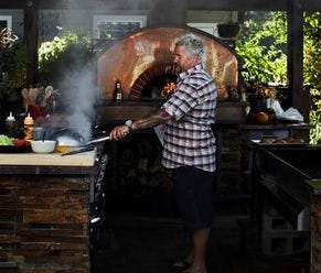 Food Network's chef Guy Fieri has been cooking in a parking lot in Sonoma, Calif. following the area's devastating wildfires.