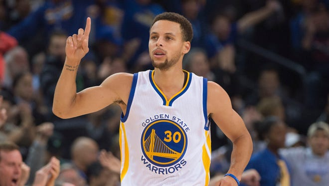 Golden State Warriors guard Stephen Curry (30) celebrates after making a basket against the Memphis Grizzlies during the first half at Oracle Arena.