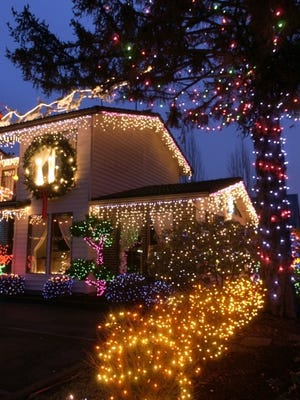 Christmas lights are festive and also can, to some degree, protect more sensitive trees and shrubs from freezing temperatures.   Statesman Journal file -  -Christmas lights illuminate the night Monday, December 1, 2003. (Lori Cain/Statesman Journal)