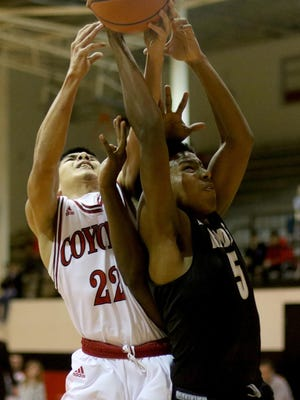 Wichita Falls High's Miguel Maldonado and Rider's Maurice Reid go up for the rebound Tuesday, Feb. 14, 2017, at Old High. Rider defeated Old High 29-25.