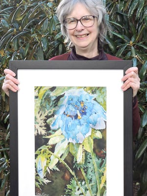 "Artist Karen Petrillose holds her painting, ""Blue Poppy,"" which was selected by the Gig Harbor Garden Tour Association as its featured art to advertise this year's tour. The work will appear on the poster, program, rack cards and other advertising for the tour, which takes place this year on June 24-25."