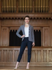 Steffi Holmes wears a double jersey knit Talbots blazer in navy and white stripe; high-waist navy ankle pants from J.Crew; ruched neckline white tank from Talbots; and nude pointed heels by Calvin Klein.