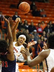 UTEP guard Najala Howell shoots the ball to teammate