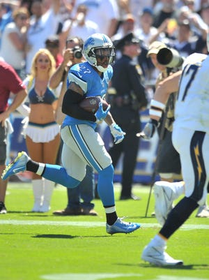 Lions safety Glover Quin runs an interception on Chargers quarterback Philip Rivers into the end zone for a touchdown in the second quarter of their season opener.