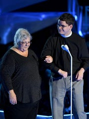 Susan Bro (L) and Robert Wright Lee IV speak onstage.